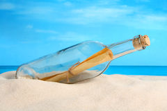 Message in a Bottle. Washed ashore royalty free stock photo