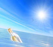 Message in a Bottle. The blue sky and beautiful white clouds with Message in a Bottle Royalty Free Stock Photography