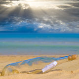 Message in a bottle. On beach royalty free stock photos