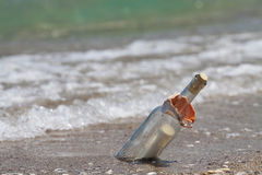 Message in a bottle on the beach. Horizontal shot with shallow depth of field Royalty Free Stock Photos
