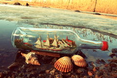 Message in a bottle. Bottle on a beach Royalty Free Stock Image