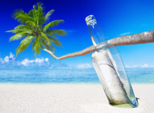 Message in a Bottle on Beach Royalty Free Stock Photos