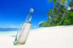 Message in a Bottle on Beach. Stock Photo