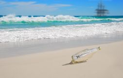 Message in Bottle on Beach Stock Photography