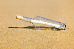 Message in a bottle on the beach.  royalty free stock images