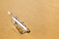 Message in a bottle on the beach.  Royalty Free Stock Photos
