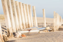 Message in a Bottle. On the beach royalty free stock photo