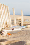Message in a Bottle. On the beach royalty free stock photos