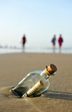 Message in a bottle on the beach. Bottle found on the beach with a message inside Royalty Free Stock Photography