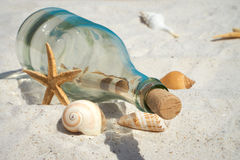 Message in a bottle on the beach Royalty Free Stock Images