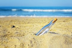 Message in a bottle on the beach stock photo