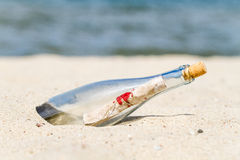 Message in a bottle on the beach Stock Photography