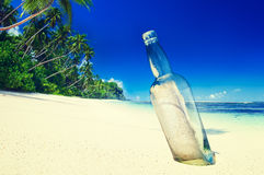Message in a Bottle on Beach Summer Paradise Cocnept Stock Photo