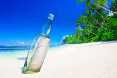 Message in a Bottle on Beach Summer Paradise Concept Stock Images