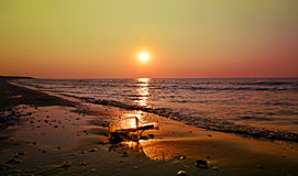 Message in a bottle on beach at sunrise. Wall art and home decoration royalty free stock photos