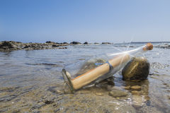 Message in a Bottle. On the beach of Tarifa, Spain Royalty Free Stock Photo