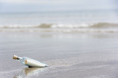 Message In A Bottle Buried In Sand Royalty Free Stock Photo