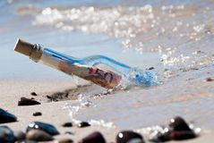 Message in a bottle euronotes Royalty Free Stock Photos