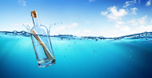 Message In Bottle floating. In The Ocean Royalty Free Stock Photos