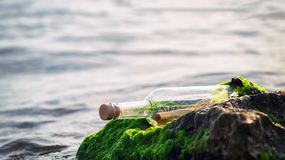 Message in bottle, help request. Sos stock image