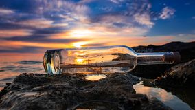 Message in bottle, help request. Sos royalty free stock images