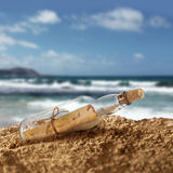 Message in the bottle. On island seashore beach sand stock photos