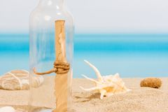 Message in bottle. On the tropical sea, with seashell e stones Stock Images