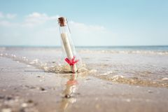 Message in a bottle. Washed up on a beach concept for help, sos, emergency and assistance Stock Image