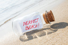 Message in a bottle Perfect vacation on sandy beach. Royalty Free Stock Photo