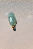 Message in a Bottle on Sand Royalty Free Stock Photos