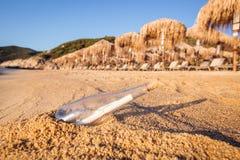 Help message bottle beach Stock Photos