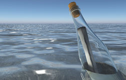 Message in a bottle in the sea Stock Image