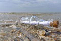 Message in a bottle. At sea Stock Images