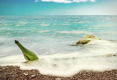 Message in bottle. On sea-beach background. toning style instagram Stock Photos