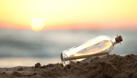 Message in a Bottle on sea beach Royalty Free Stock Image