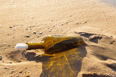 Message in a bottle. On a sea shore Royalty Free Stock Photo