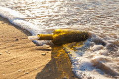 Message in a bottle. On a sea shore Royalty Free Stock Images