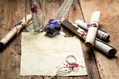 Message in bottle with a sealed message. On old wooden table stock images