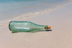 Message in a Bottle on Shore Royalty Free Stock Image