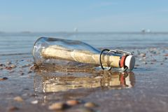 Message in a bottle. Stranded on the beach stock images