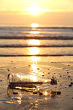 Message in a bottle. Stranded on the beach Stock Photo