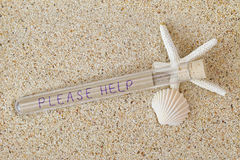 Message in a bottle style with cork lid and wordings Please Help Stock Photography