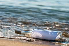 Message in a bottle in the surge stock image