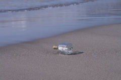 Message in a Bottle on a Tropical Beach Royalty Free Stock Images