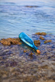 Message in a bottle washed ashore. On a reef in Hawaii Royalty Free Stock Images