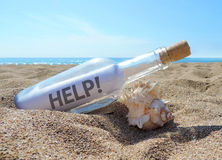 Message in a bottle. Washed ashore the beach Royalty Free Stock Photography