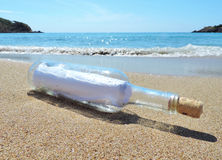 Message in a bottle. Washed ashore the beach Stock Image