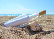 Message in a bottle. Washed ashore the beach Royalty Free Stock Photos