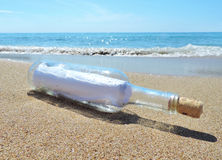 Message in a bottle. Washed ashore the beach Stock Images