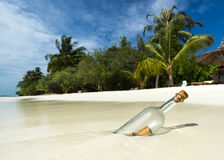Message in a bottle washed ashore Stock Image